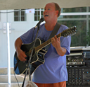 Paul Phillips plays live music at the Apple House Market.
